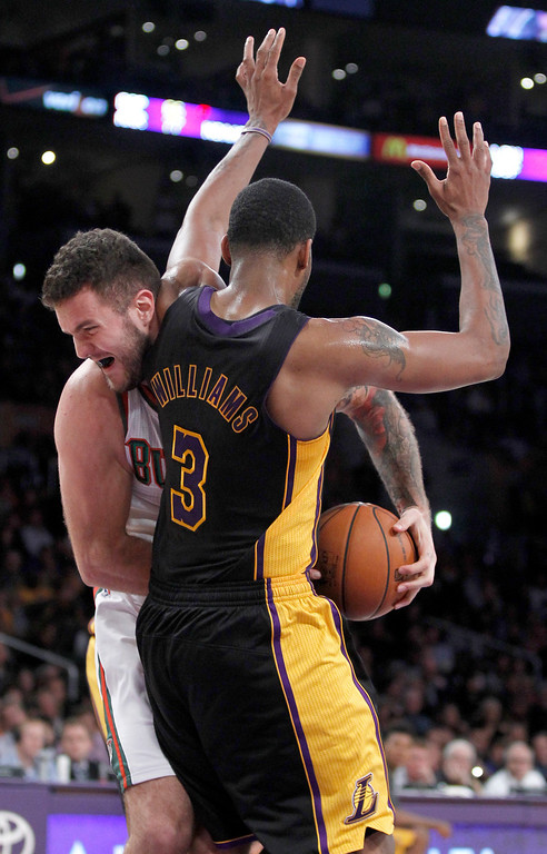 . Milwaukee Bucks center Miroslav Raduljica, of Serbia, collides with Los Angeles Lakers forward Shawne Williams (3) during the second half of an NBA basketball game Tuesday, Dec. 31, 2013, in Los Angeles. The Bucks won 94-79. (AP Photo/Alex Gallardo)