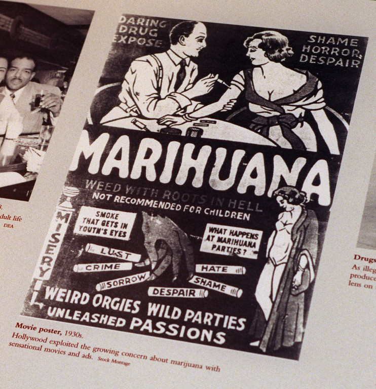 """. FILE - This undated file photo provided by the Drug Enforcement Administration shows a 1930s anti-marijuana movie poster as part of an exhibit at the DEA Museum and Visitors Center which opened May 10, 1999 in Arlington, Va. After the repeal of alcohol prohibition in 1933, Harry Anslinger, who headed the Federal Bureau of Narcotics, turned his attention to pot. He told of sensational crimes reportedly committed by marijuana addicts. \""""No one knows, when he places a marijuana cigarette to his lips, whether he will become a philosopher, a joyous reveler in a musical heaven, a mad insensate, a calm philosopher, or a murderer,\"""" he wrote in \""""Marijuana: Assassin of Youth,\"""" in 1937. On the occasion of  �Legalization Day,� Thursday, Dec. 6, 2012, when Washington�s new law takes effect, AP takes a look back at the cultural and legal status of the �evil weed� in American history. (AP Photo/DEA, File)"""