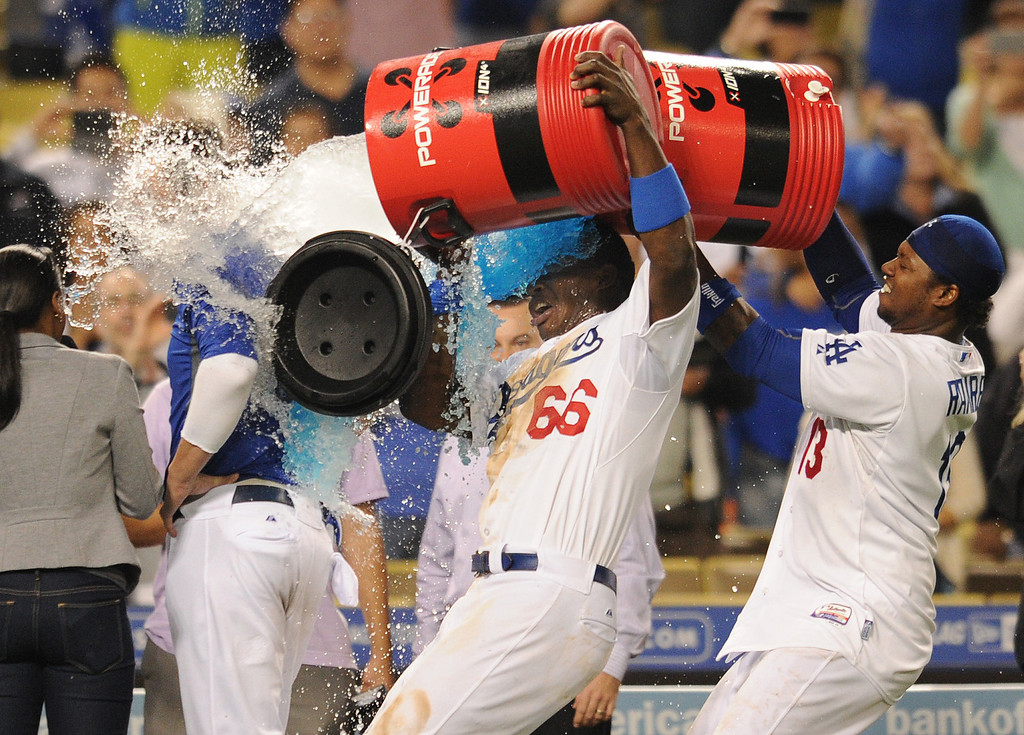 . Yasiel Puig and Hanley Ramirez dump water on Scott Van Slyke as he gives an interview after the game. The Dodgers defeated the Arizona Diamondbacks 5-3 after Scott Van Slyke hit a 2 run walk off homer in the 11 inning at Dodger Stadium in Los Angeles, CA. 9/10/2013. photo by (John McCoy/Los Angeles Daily News)