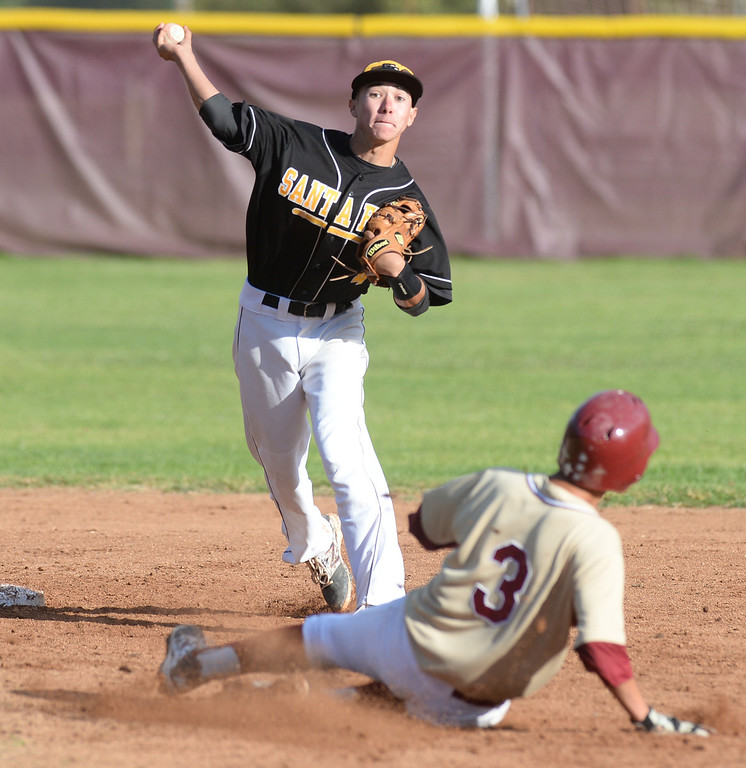 . Santa Fe shortstop Anthony Gonzalez (#4) forces out La Serna\'s Paul Barraza (#3) and completes the double play in the 10th inning in their Del Rio League baseball game at La Serna High School in Whittier on Wednesday April 2, 2014. Santa Fe defeated La Serna 2-0 in 12 innings. (Staff Photo by Keith Durflinger/Whittier Daily News)