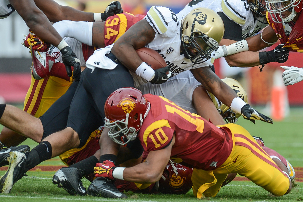 . Colorado\'s Christian Powell is hammered by USC\'s Hayes Pullard during the first half against Colorado Saturday.  USC defeated Colorado 50-6.  (10/20/12) Photo by David Crane/L.A. Daily News
