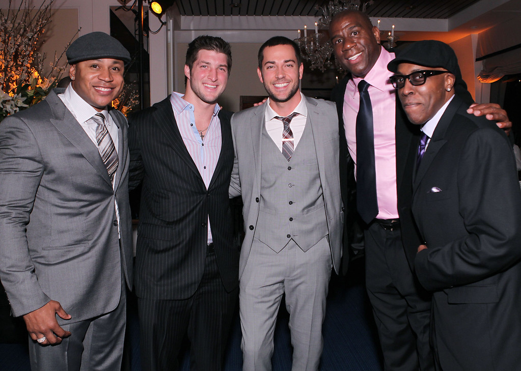". Actor and music recording artist LL Cool J, from left, NFL football player Tim Tebow, actor Zachary Levi, former NBA basketball player Earvin ""Magic\"" Johnson and actor Arsenio Hall attend LL Cool J\'s pre-Grammy party hosted by Hennessy, on Saturday, February 11, 2012 in Los Angeles.(Chris Weeks /AP Images for Hennessy)"