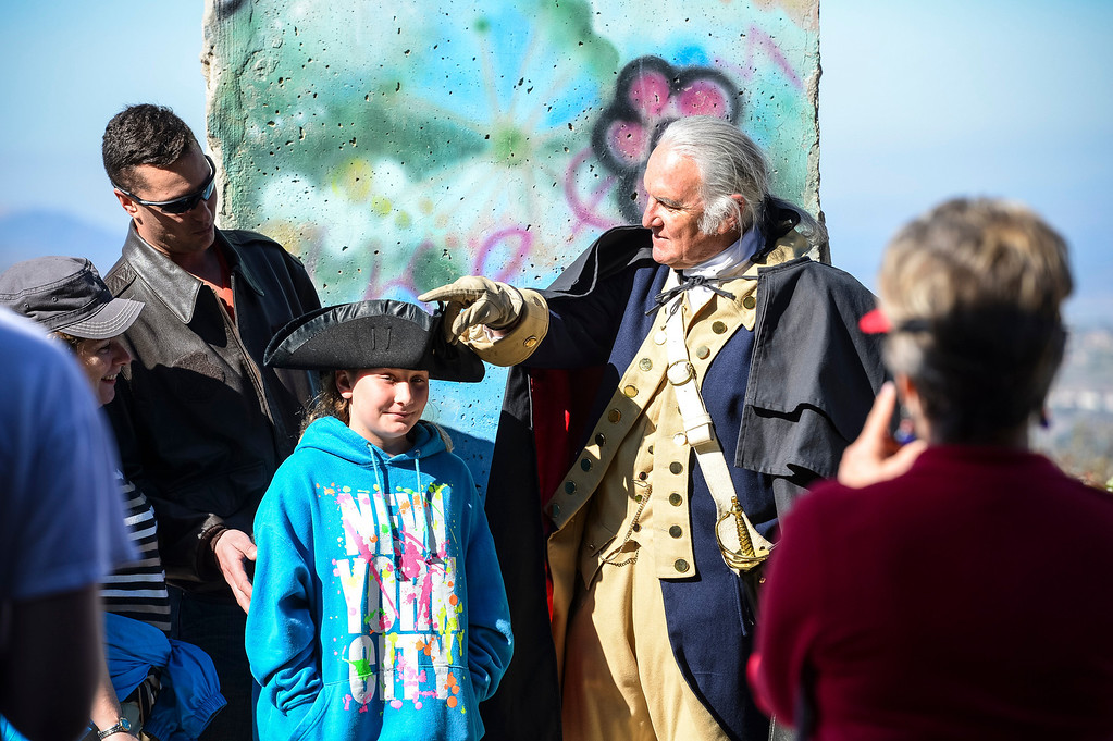 . George Washington, portrayed by Roger Cooper, lets a visitor try on his hat for size on Presidents Day at the Ronald Reagan Presidential Library in Simi Valley, CA on February 17, 2014.   (Photo by David Crane/Los Angeles Daily News)