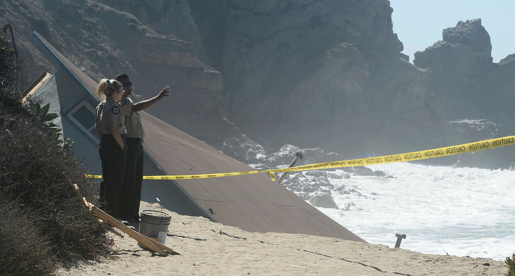 . Aug 28,2014, Malibu CA. State Park rangers look over a collapse lifeguard station that fell into the ocean late Wednesday night from the big waves from hurricane Marie. The building has been at the Point Mugu state park along PCH for over 30yrs and no one was hurt. Photo by Gene Blevins/LA Daily News