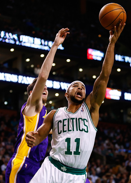 . BOSTON, MA - JANUARY 17:  Jerryd Bayless #11 of the Boston Celtics goes up for a layup past Ryan Kelly #4 of the Los Angeles Lakers in the second quarter during the game at TD Garden on January 17, 2014 in Boston, Massachusetts.   (Photo by Jared Wickerham/Getty Images)