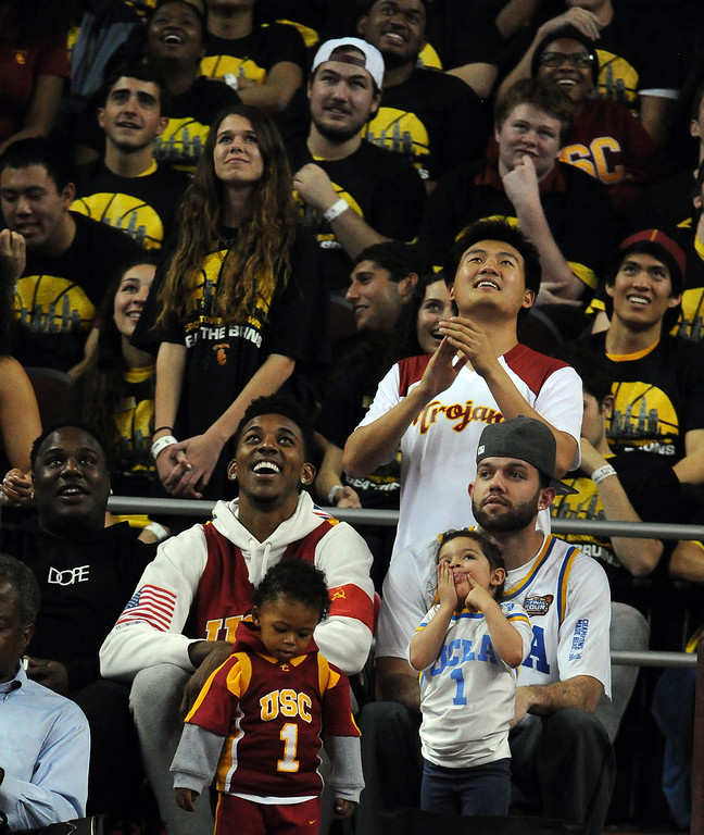 . Los Angeles Lakers and former Trojan, Nick Young, left, with Jordan Farmer former Bruins look on in the second half of a PAC-12 NCAA basketball game between the UCLA and Southern California at Galen Center in Los Angeles, Calif., on Saturday, Feb. 8, 2014. UCLA won 83-73. (Keith Birmingham Pasadena Star-News)