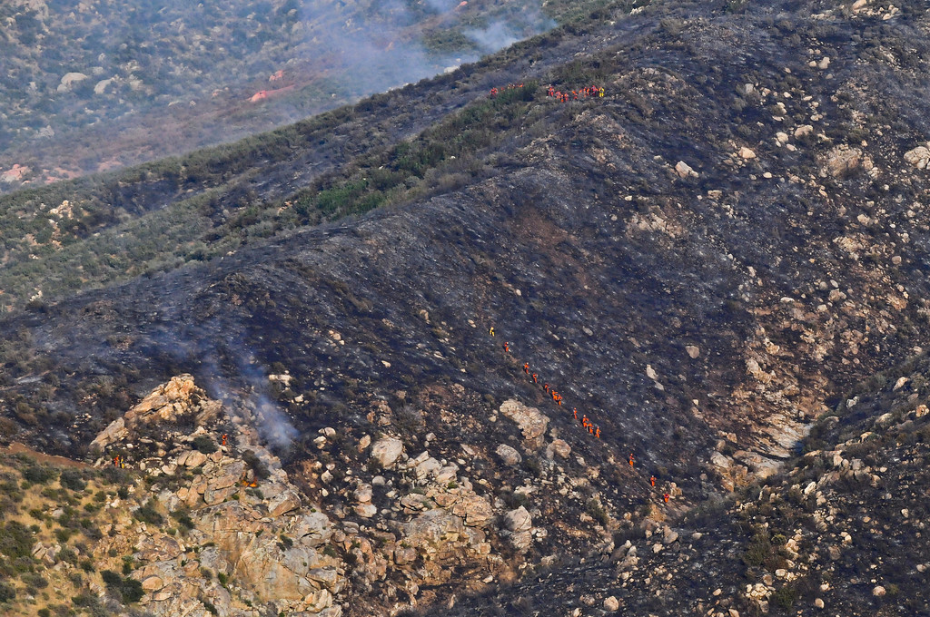 . A wildfire burns in the canyons along Highway 243 south of Banning on Saturday, May 4, 2013. More than 400 firefighters battled the 650-acre fire on Saturday. (Rachel Luna / Staff Photographer)