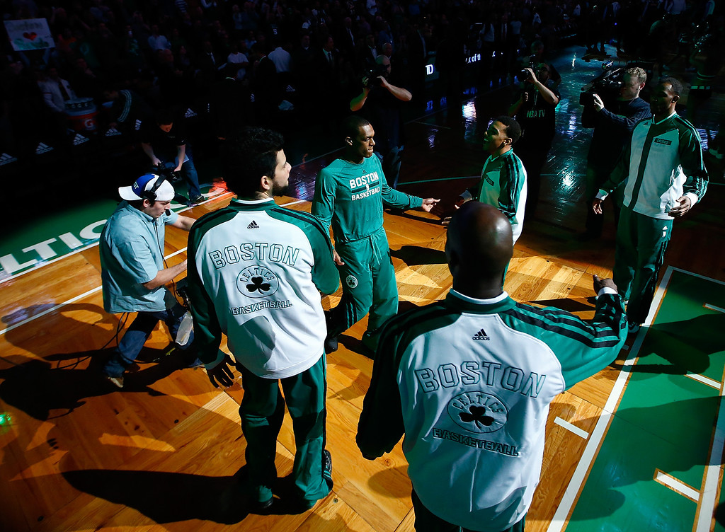 . BOSTON, MA - JANUARY 17:  Rajon Rondo #9 of the Boston Celtics is introduced with his teammates as part of the starting lineup prior to the game against the Los Angeles Lakers at TD Garden on January 17, 2014 in Boston, Massachusetts.   (Photo by Jared Wickerham/Getty Images)