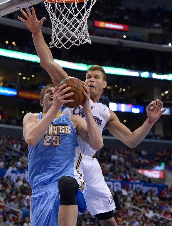 . Denver#25 Timofey Mozgov gets past Clippers#32 Blake Griffin in the second half. The Los Angeles Clippers defeated Denver Nuggets 117 to 105 in a regular season NBA game. Los Angeles, CA. 4/15/2014(Photo by John McCoy / Los Angeles Daily News)