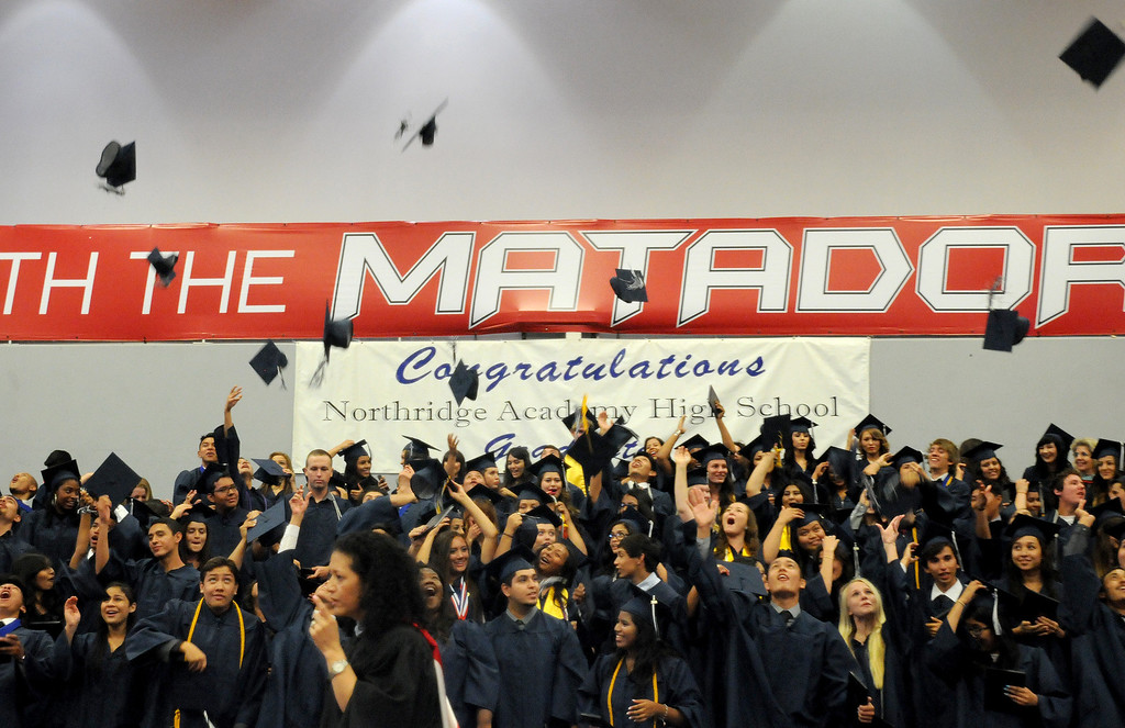 . Some of the students at the Northridge Academy High School graduation ceremony toss their mortar boards on Thursday, June 5, 2014. (Photo by Dean Musgrove/Los Angeles Daily News)