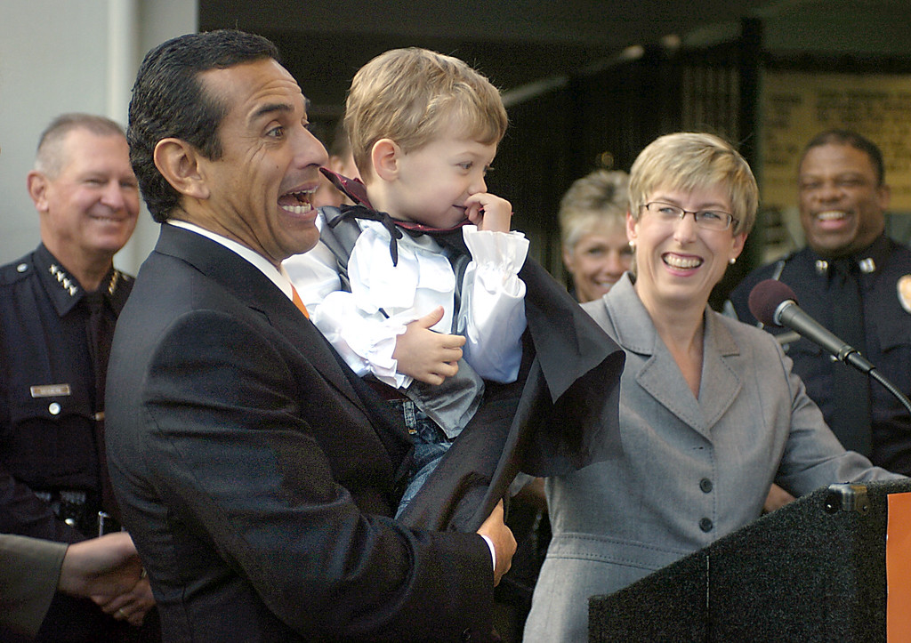 . Mayor Antonio Villaraigosa holds councilwoman Wendy Greuel\'s son, Thomas Schramm (Los Angeles Daily News file photo)