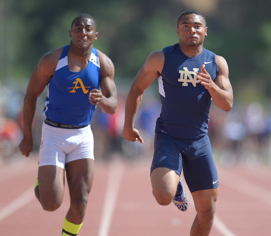 . Notre Dame\'s Khalfani Muhammad powers to a win in the 100 meter Division 3 race of the CIF Southern Section Track and Field Championships Saturday at Mt. SAC.  20130518 Photo by Steve McCrank / Staff Photographer