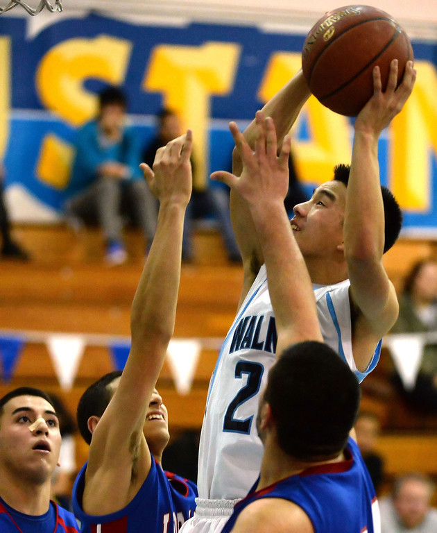 . Walnut\'s Jeff Huang (21) drives to the basket against Los Altos in the second half of a prep basketball game at Walnut High School in Walnut, Calif., on Wednesday, Jan. 22, 2014. (Keith Birmingham Pasadena Star-News)