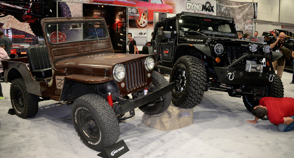 . Nov 6,2013 Las Vegas NV. USA. Some old and new Jeeps on display during the second day of the 2013 SEMA auto show.