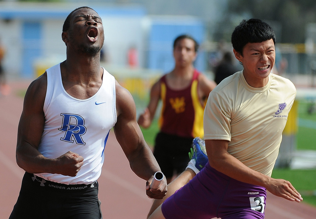 . Diamond Ranch\'s Will Bryan, left, finishes first ahead of Diamond Bar\'s Ryan Gan, right, during the 4x100 relay during the Hacienda League track finals in Walnut, Calif., on Thursday, May 8, 2014.  (Keith Birmingham Pasadena Star-News)