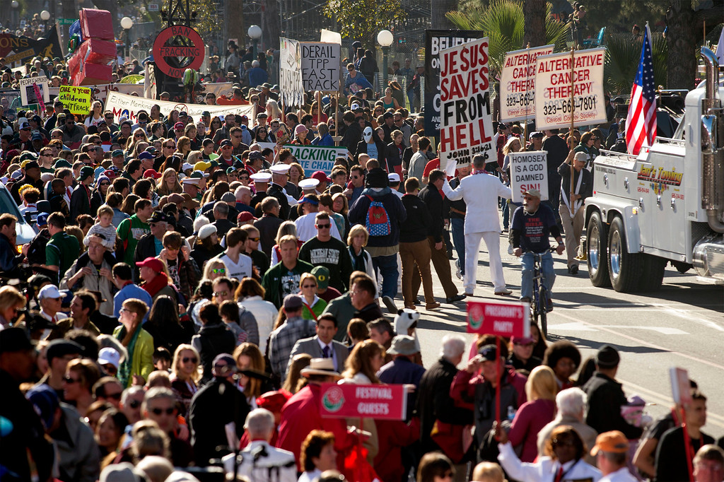 . Protestors with the Occupy Movement fall in behind at the end of the Rose Parade in Pasadena, Calif. Jan. 1, 2014.  (Staff photo by Leo Jarzomb/Pasadena Star-News)