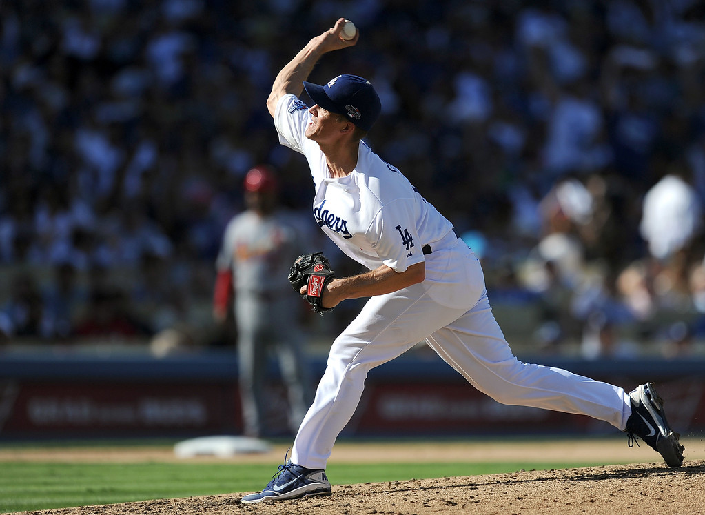 . Los Angeles Dodgers\' pitcher Zack Greinke throws out St. Louis Cardinals\' Yadier Molina in the sixth during game 5 of the NLCS at Dodger Stadium Wednesday, October 16, 2013. (Photo by Hans Gutknecht/Los Angeles Daily News)