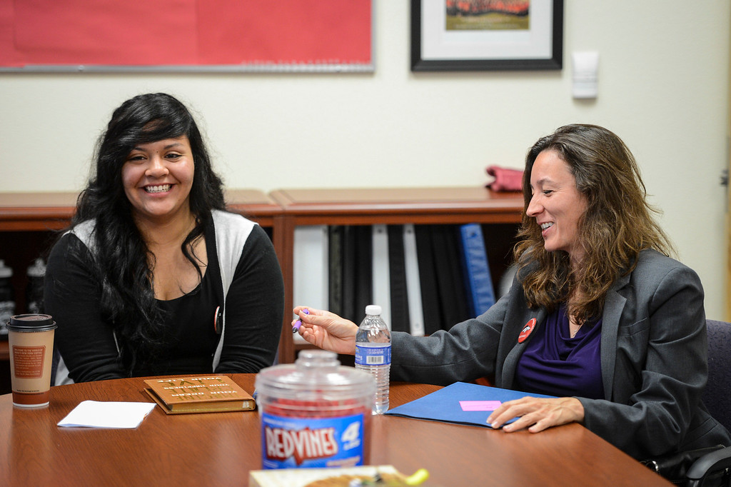 . Arleta high senior Magdelena Sanchez, 17, lets newly elected LAUSD school board member Monica Ratliff borrow her pen during a tour of her high school.  Tuesday is the first day of school for the Los Angeles Unified School District. Photo by David Crane/Los Angeles Daily News