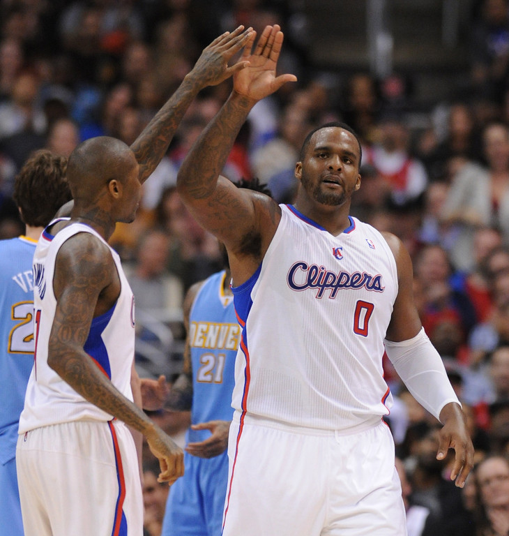 . Clippers#0 Glen Davis celebrates in the second half. The Los Angeles Clippers defeated Denver Nuggets 117 to 105 in a regular season NBA game. Los Angeles, CA. 4/15/2014(Photo by John McCoy / Los Angeles Daily News)