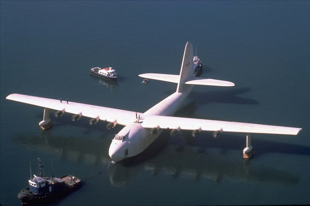 """. Howard Hughes\' wooden flying boat the \""""Spruce Goose,\"""" is towed by a tugboat from its hangar in Long Beach, Calif., in this Oct. 29, 1980 file photo. In 1947, Hughes flew the Spruce Goose to prove a point to Sen. Owen Brewster, R-Maine, who led the Senate War Investigating Committee. (AP Photo)"""