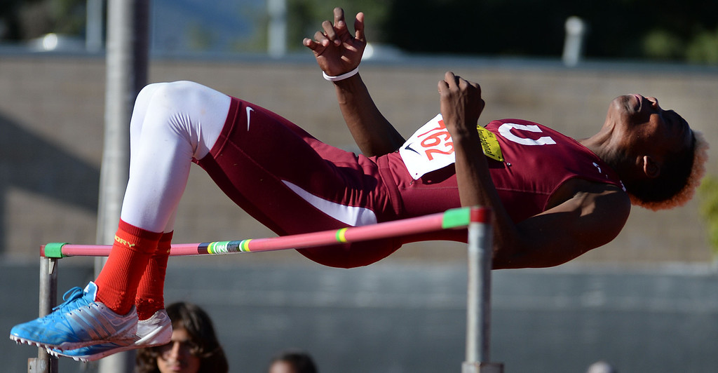 . Covina\'s D\'Juan Shamburger competes in the high jump during the Arcadia Invitational track and field meet at Arcadia High School in Arcadia, Calif., on Friday, April 11, 2014.  (Keith Birmingham Pasadena Star-News)