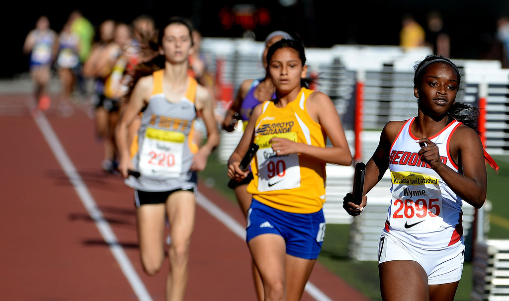 . Redondo Union\'s Breya Wynee, right, during the 4x800 meter relay invitational race during the Arcadia Invitational track and field meet at Arcadia High School in Arcadia, Calif., on Friday, April 11, 2014. Clovis North won the race as Redondo Union finished second.  (Keith Birmingham Pasadena Star-News)