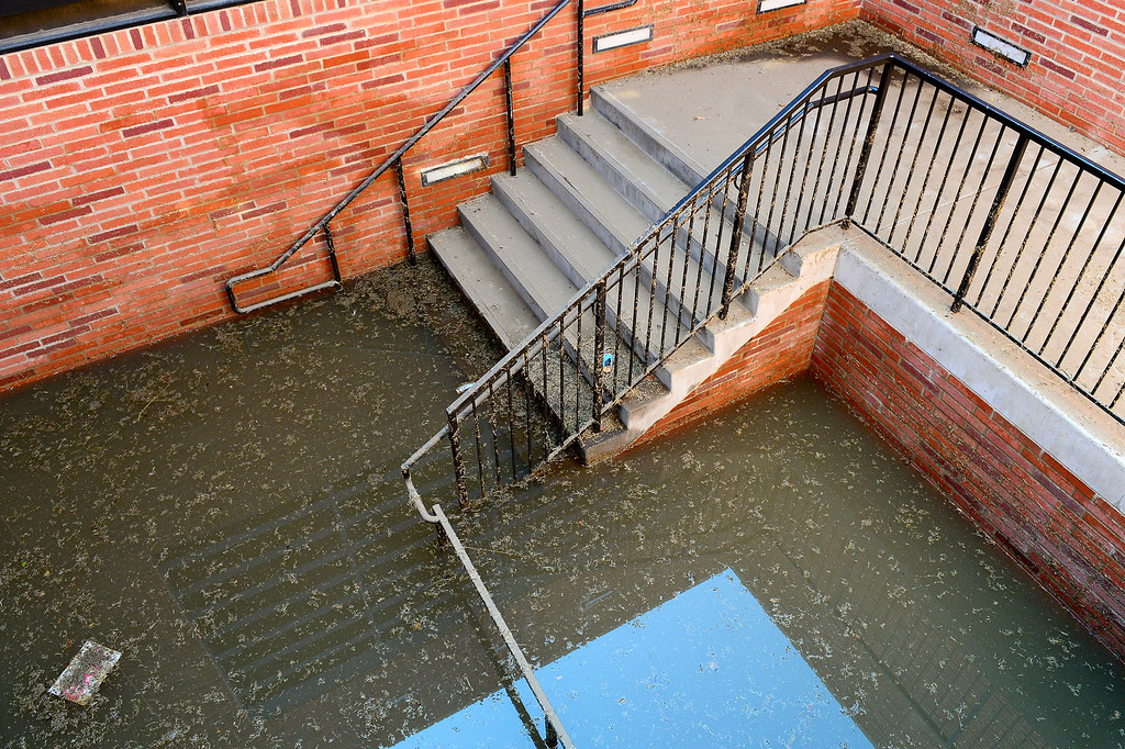 . A stairwell leading from parking structure 7 is still flooded at UCLA, Wednesday, July 30, 2014. (Photo by Michael Owen Baker/Los Angeles Daily News)