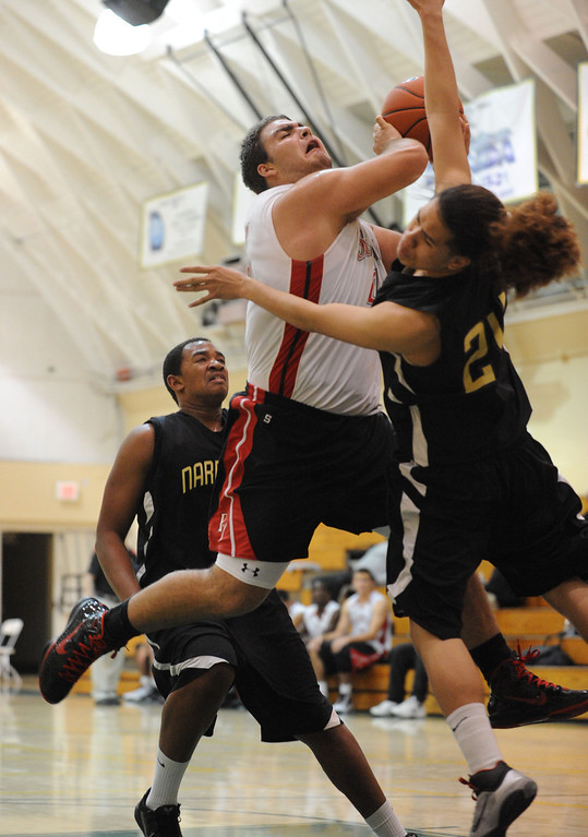 . Narbonne\'s Shailo Leafa (24) collides with Palos Verdes\' Al Bjekovic (44) in a pool-play basketball game of the Mira Costa Pacific Shores Tournament Wednesday. Narbonne won the tight game 60-57. December 01, 2010.  Photo by Steve McCrank/Daily Breeze