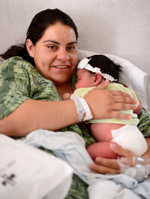 . Yvette Camberos, of Bell Gardens, spends time with her nearly 14 pound baby Kaelyn Hernandez Saturday, May 25, 2013 at Whittier Hospital Medical Center. The baby, born late Friday via C-section, is the largest baby born at the hospital that anyone can remember. (SGVN/Staff Photo by Sarah Reingewirtz)