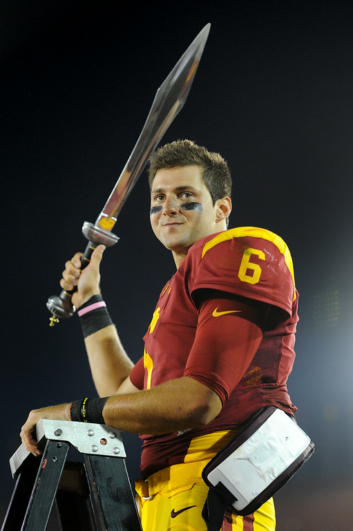 . USC QB Cody Kessler stands on a ladder as the band plays their victory song after beating Fresno State 52-13, Saturday, August 30, 2014, at the L.A. Memorial Coliseum. (Photo by Michael Owen Baker/Los Angeles Daily News)