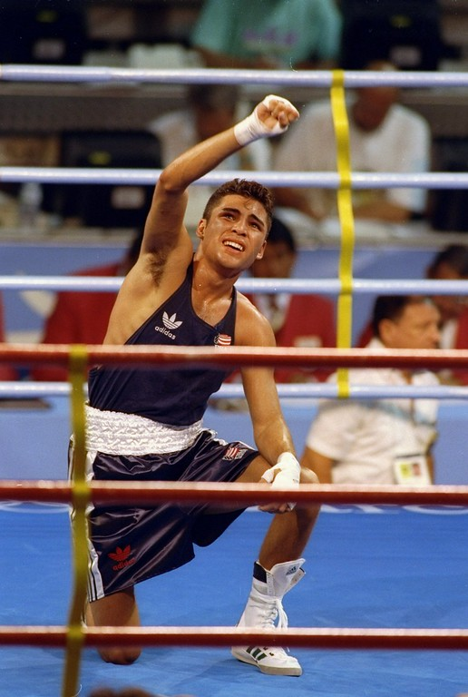 . 1992:  Oscar De La Hoya kneels in the ring during the Olympic Games in Barcelona, Spain. Mandatory Credit: Mike Powell  /Allsport
