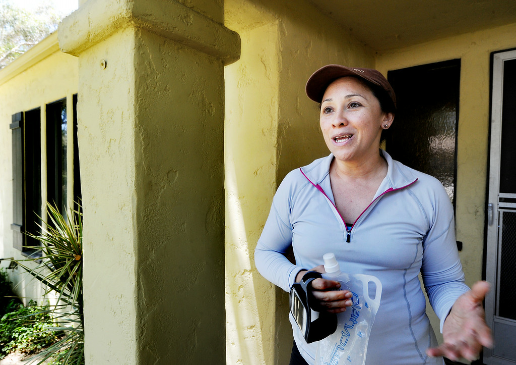 . Gloria Contreras in front of a Caltrans home at 533 Prospect Avenue in South Pasadena Tuesday, July 8, 2014. Gloria and her husband are very happy that they will finally have a possible opportunity to purchase the home that they have rented from Caltrans for 3 years. Fifty-three properties owned by Caltrans have gone back on the market after years of being state-owned rentals. The properties were once reserved to be demolished for the possible 710 freeway extension, but Caltrans now says they are outside the footprint of the five remaining options being studied by the agency to complete the freeway. Caltrans was also prompted to sell the homes by a state law passed last year.(Photo by Walt Mancini/Pasadena Star-News)