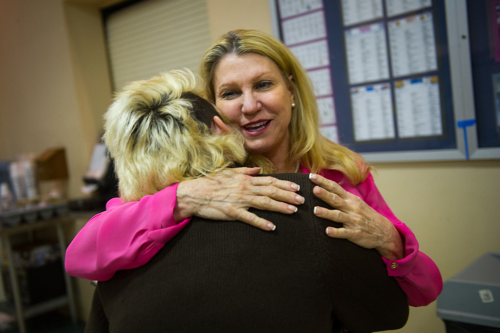 . Lois Lee, founder and president of Children of the Night, gets a hug from a teen prostitute staying at Children of the Night in Van Nuys. Monday, March 17, 2014. (Photo by Michael Owen Baker/L.A. Daily News)