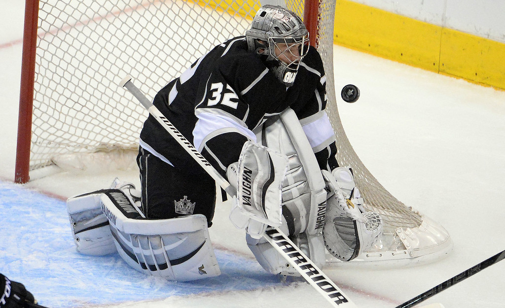 . Los Angeles Kings goalie Jonathan Quick blocks a San Jose Sharks shot during the first period in Game 4 of an NHL hockey first-round playoff series at Staples Center in Los Angeles on Thursday, April, 24  2014.  (Keith Birmingham Pasadena Star-News)