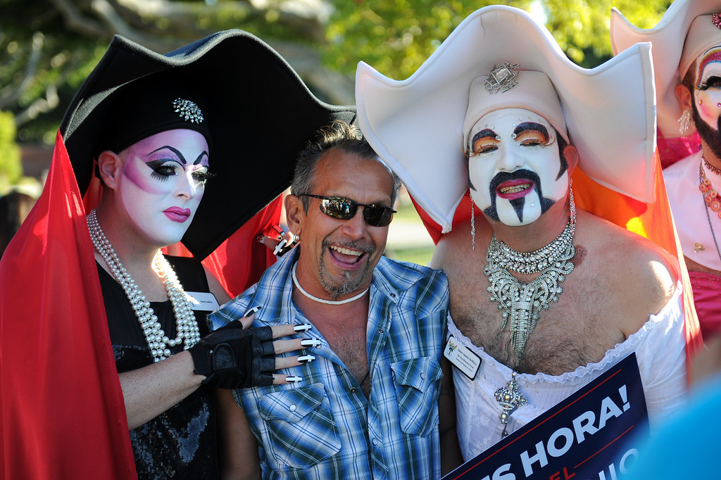 """. Lawrence Herrera, center, poses with \""""Sister Indica,\"""" left, and \""""Sister Tootie Toot\"""" at the rally in West Hollywood to celebrate the U.S. Supreme Court\'s ruling that killed Prop 8, Wednesday, June 26, 2013. (Michael Owen Baker/L.A. Daily News)"""