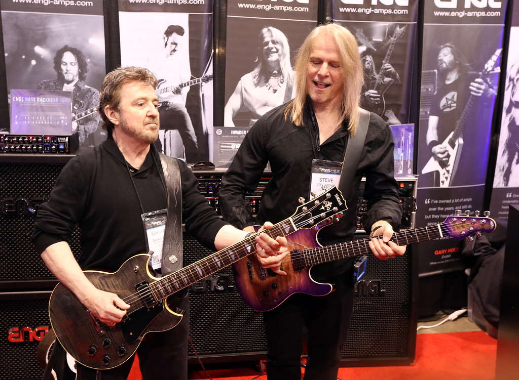 ". ANAHEIM, CA - JANUARY 23: Donald Brian ""Buck Dharma\"" Roeser and Steve Morse attend the 2014 National Association of Music Merchants show at the Anaheim Convention Center on January 23, 2014 in Anaheim, California.  (Photo by Jesse Grant/Getty Images for NAMM)"