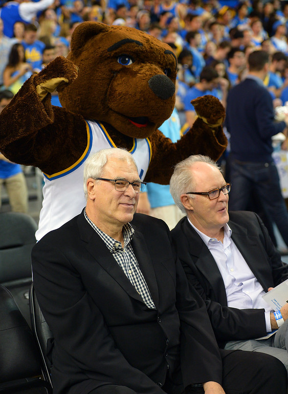 . Phil Jackson and John Lithgow are photobombed by Joe Bruin at the UCLA-Arizona game, Thursday, January 9, 2014, at Pauley Pavilion. (Photo by Michael Owen Baker/L.A. Daily News)