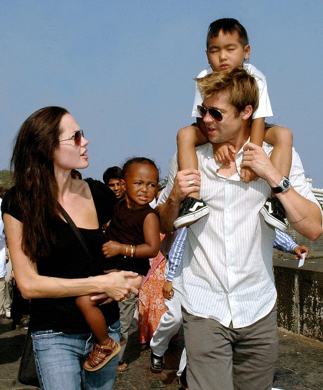 ". MUMBAI, INDIA:  US actors Angelina Jolie (L), daughter Zahara (2L), husband Brad Pitt (R), and son Maddox take a stroll on the seafront promenade in Mumbai, 12 November 2006.  Jolie and Pitt are in Mumbai, India\'s financial hub, to shoot for her film ""A Mighty Heart\"", based on the life of the slain Wall Street Journal reporter Daniel Pearl in which Jolie portrays Marianne, the wife of Daniel Pearl.  (STR/AFP/Getty Images)"