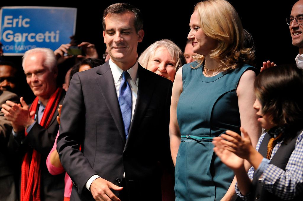 . Los Angeles Mayoral candidate Eric Garcetti leaves the stage with his wife Amy Wakeland after his speech. Garcetti held his election night party at The Hollywood Palladium where supporters showed hear him speak. Hollywood, CA 5/22/2013(John McCoy/LA Daily News)