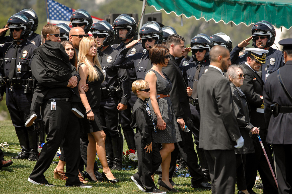 . Family members arrive at the burial of LAPD officer Chris Cortijo, Tuesday, April 22, 2014, at Forest Lawn Hollywood Hills. (Photo by Michael Owen Baker/L.A. Daily News)