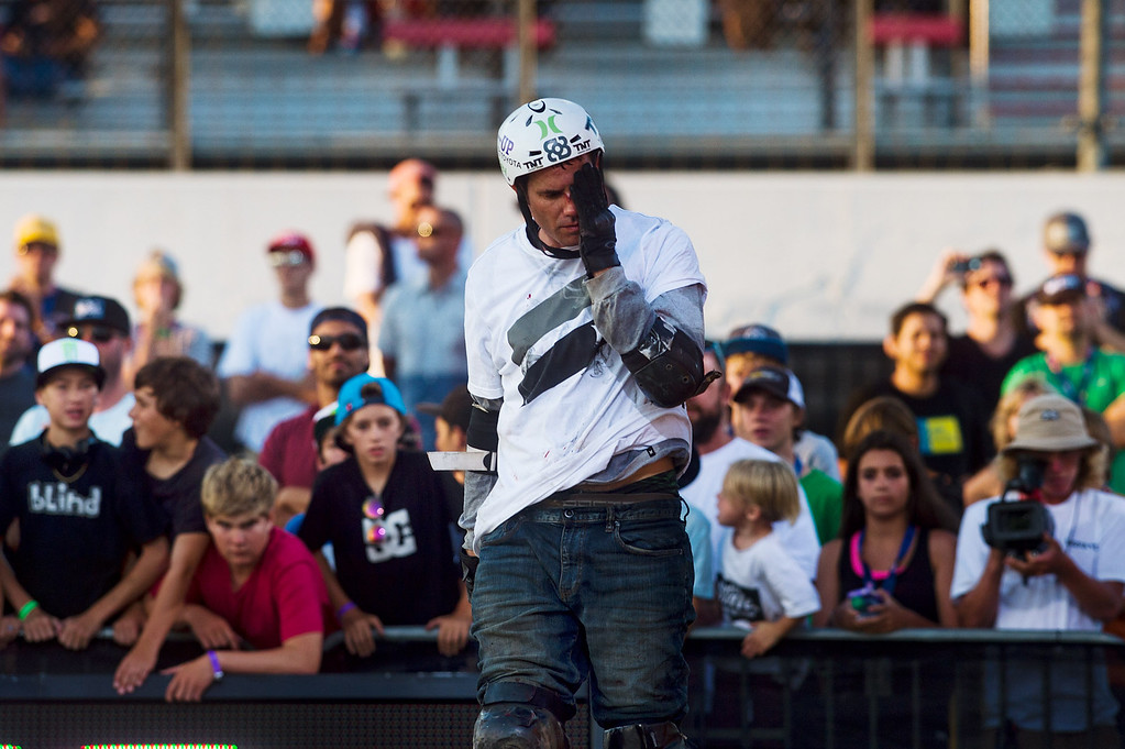 . Bob Burnquist holds his face after he crash-landed on his face in the America\'s Navy Skateboard Big Air final during X Games Los Angeles at Irwindale Event Center in Irwindale on Thursday, August 1, 2013. (SGVN/Staff photo by Watchara Phomicinda)