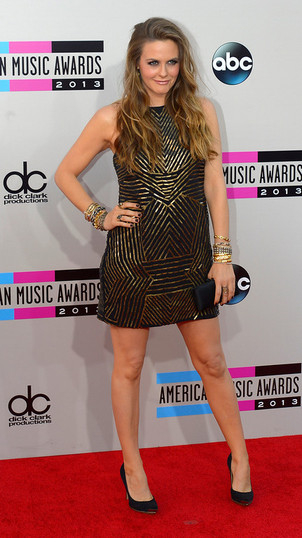 . Alicia Silverstone arrives to the American Music Awards  at the Nokia Theatre in Los Angeles, California on Sunday November 24, 2013 (Photo by Andy Holzman / Los Angeles Daily News)