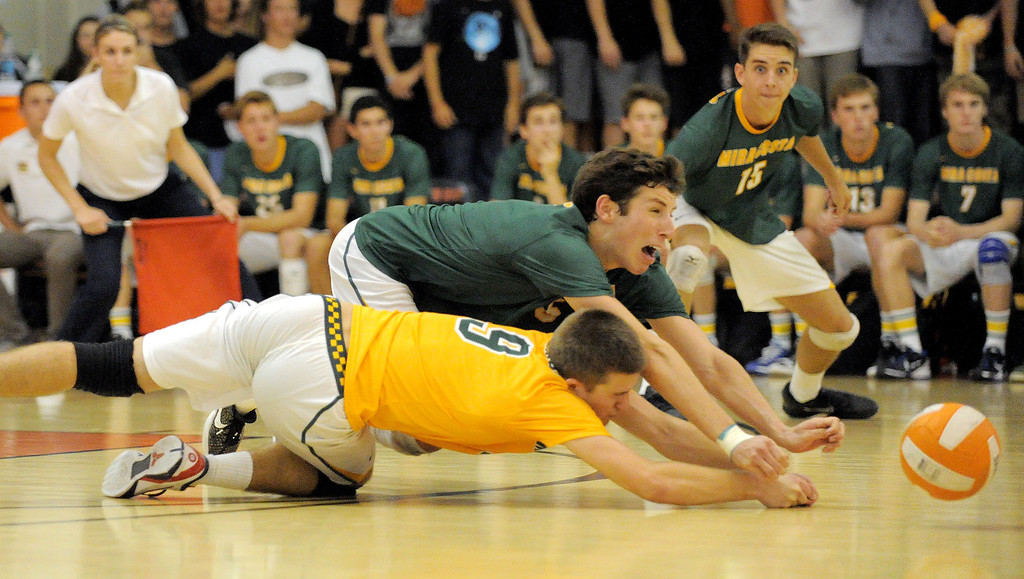 . 05-15-2013-( Daily Breeze Staff Photo by Sean Hiller) Huntington Beach swept Mira Costa in Wednesday\'s  boys volleyball CIF Southern Section Division I semifinal at Huntington Beach High School. Dillon Shambaugh (9), front, and Casey White dive to try and save the ball.