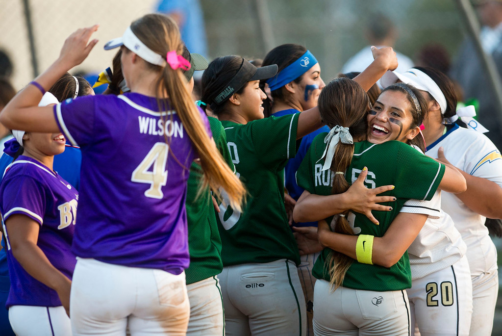 . Players on both teams celebrate after the San Gabriel Valley all-star softball game at Diamond Bar High School on Monday, June 3, 2013. South team won 10-5. (Staff photo by Watchara Phomicinda/ Los Angeles Media News Group)