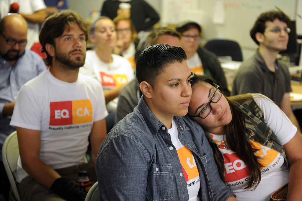 . Alicia Guajrado and Isabella Restrepo wait at Equality California in West Hollywood to hear  the Supreme Court on the the Defense of Marriage Act and  California\'s Proposition 8 ballot initiative Wednesday, June 26, 2013. Equality California is the largest lesbian, gay, bisexual and transgender rights organization in California. (Hans Gutknecht/Los Angeles Daily News)