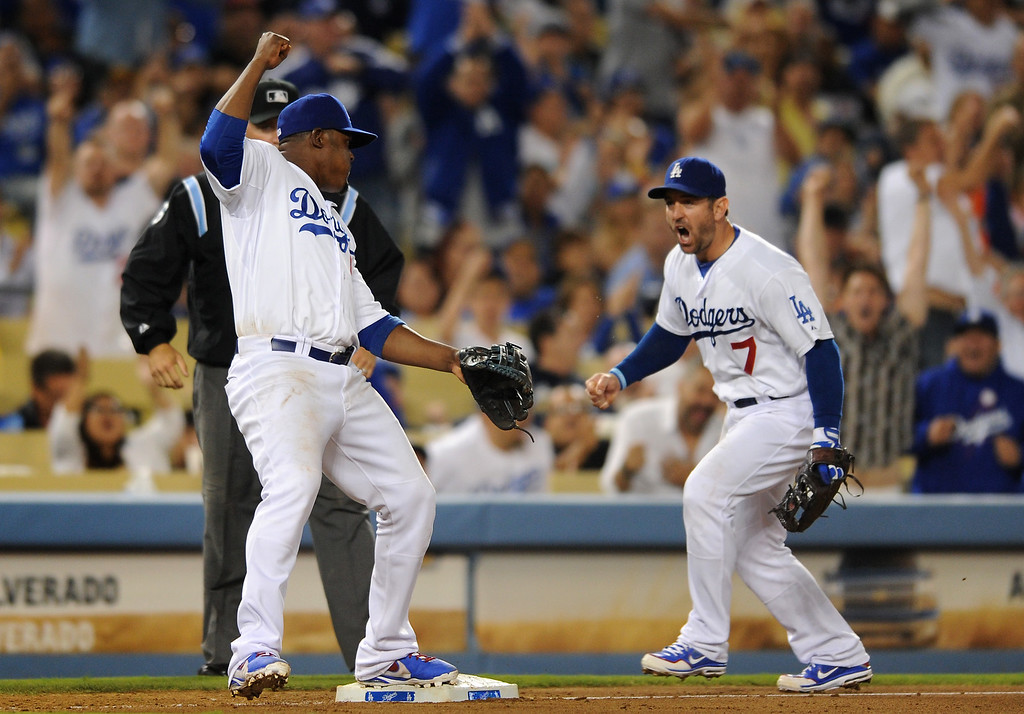 . Dodgers\' Juan Uribe and Nick Punto celebrate after Uribe turned a double-play to end a threat by the Giants with the bases loaded in the eighth-inning, Thursday, September 12, 2013, at Dodger Stadium. (Photo by Michael Owen Baker/L.A. Daily News)