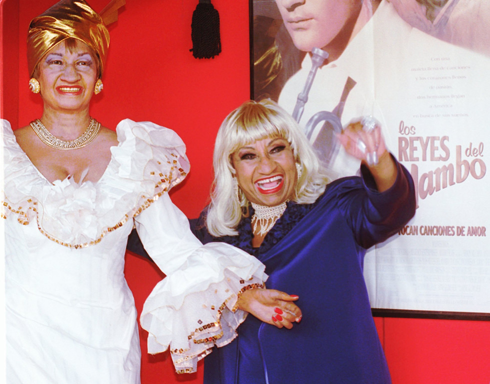 ". Actress and Grammy Award winner Celia Cruz, also dubbed the ""Queen of Latin Music,\"" stands next to her wax figure after it was unveiled during a ceremony at the Hollywood Wax Museum Monday, Sept. 30, 1996 in the Hollywood section of Los Angeles. Cruz also donated the dress she wore in the film \""Mambo Kings\"" to grace her wax figure. (AP Photo/Rene Macura)"