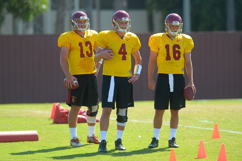 . USC quarterbacks look on during a practice at the Howard Jones Field at USC Monday August 19, 2013.  The Trojans start the season on August 29th with a game against Hawaii.(Andy Holzman/Los Angeles Daily News)