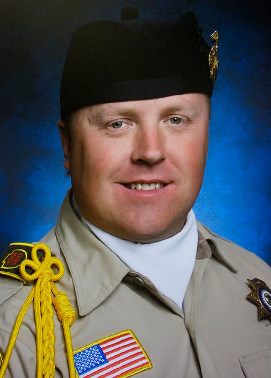 . A photo of Deputy Jeremiah MacKay at the San Bernardino County Sheriff\'s Department\'s press conference Wednesday, February 13, 2013, at the San Bernardino County Sheriff\'s Headquarters in San Bernardino.