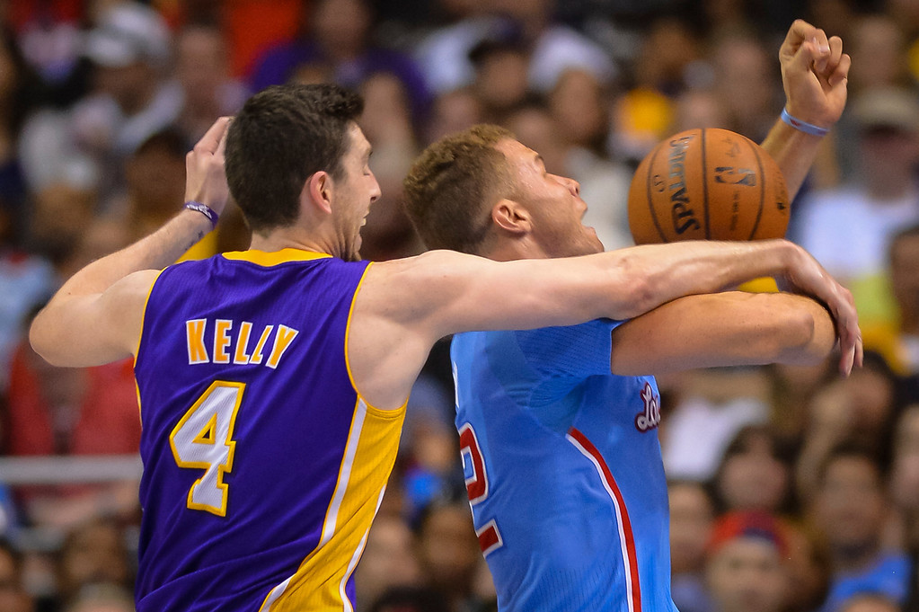 . Lakers� Ryan Kelly wraps up Clippers Blake Griffin during game action at Staples Center Sunday April 6, 2014. Clippers defeated the Lakers 120-97.  ( Photo by David Crane/Los Angeles Daily News )